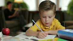 Boy doing homework, dolly shot Stock Footage