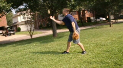 Man tossing ball in the air slow motion Stock Footage