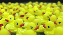 Yellow rubber ducks flowing in circle Stock Footage