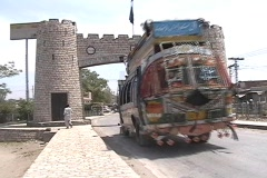 Bus going through The Khyber Pass Gate - stock footage