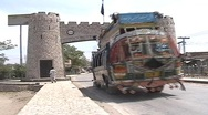 Bus going through The Khyber Pass Gate Stock Footage