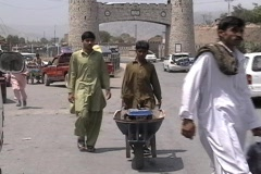 Man and Boy with Wheelbarrow in Khyber Agency; Jamrud City - stock footage