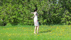 Woman dancing in green field - stock footage