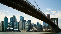 Time lapse of downtown NYC under Brooklyn Bridge Stock Footage