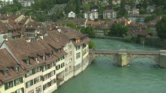 River bend with bridge and houses Stock Footage
