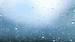 Beautiful rain drops fall in slow motion. Loop - stock footage
