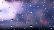 Beautiful rain drops fall in slow motion. Loop Stock Footage