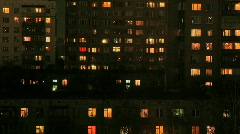 Multi-story housing at evening with windows lighting, HD Stock Footage