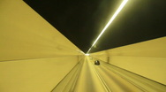 Car driving fast in tunnel Stock Footage