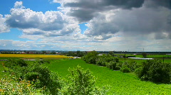 Sun and Cloudy sky before storm over landscape time laps Stock Footage