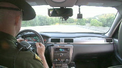 State Trooper Driving in Cruiser (HD) c Stock Footage