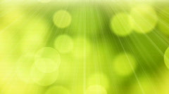 Loopable abstract background slowly flying green yellow circle bokeh lig Stock Footage