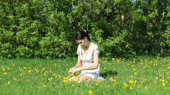 She weaves a wreath of dandelions2 Stock Footage