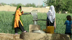 Girls Pumping Water (HD) c Stock Footage