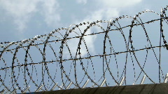 Barbed wire fence with cloud sky - stock footage