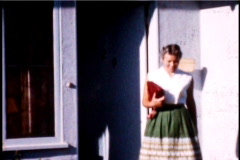 People Leaving a house 1950's 8mm footage  - stock footage