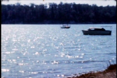 Lake scene from 1950's boats vistas - stock footage