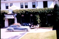 Hotel and Vintage Cars 1950's Pan shot - stock footage