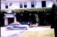 Hotel and Vintage Cars 1950's Pan shot Stock Footage