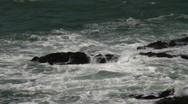 Stock Video Footage of Waves Rocks Quick Zoom In