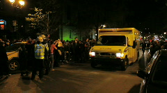 Ambulance goes by riot police and fans celebrating Stock Footage