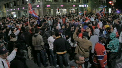 Crowds celebrate in the streets 1 Stock Footage