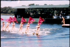 Water Skiing Show with Flags 1950's  - stock footage