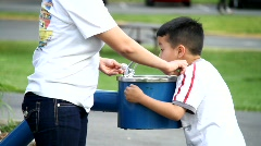 Child at water fountain Stock Footage