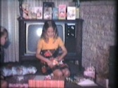 Girl Gets Money For Her Birthday (1976 Vintage 8mm film) Stock Footage