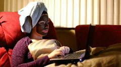 Girl with Chocolate Masque on Computer Stock Footage