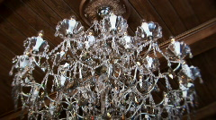 Chandelier lights up Stock Footage
