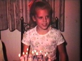 Stock Video Footage of Little Girl Turns Ten (1975 - Vintage 8mm film)