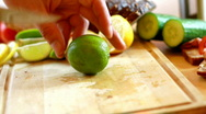 Slicing lime Stock Footage