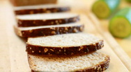 Slices whole grain bread and vegetables, dolly shot Stock Footage