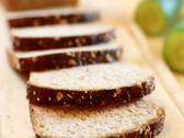 Stock Video Footage of Slices whole grain bread and vegetables, dolly shot