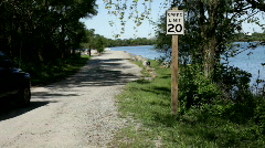 20 MPH Speed sign next to Lake - stock footage