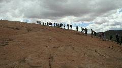 Hikers walking up sandstone Stock Footage