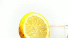 Rotating lemon  slice on glass Stock Footage