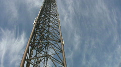 Workers descending giant tower. Stock Footage