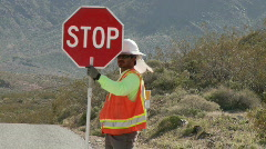 Construction Worker with stop sign Stock Footage