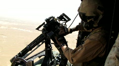 Helicopter crewman loads weapon (HD) k Stock Footage