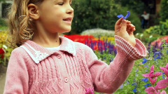 Girl stands on path in botanical park Stock Footage