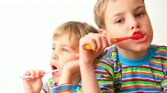 Boy and girl brush teeth Stock Footage