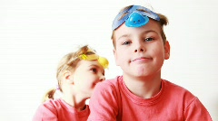Boy and girl lower masks on person Stock Footage