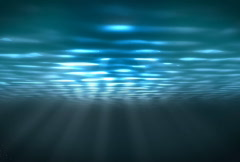 Underwater scene with sunrays shining through the water's surface. (Looping) Stock Footage