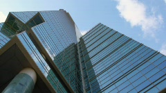 Shooting from below upwards corners, walls and windows of skyscraper Stock Footage