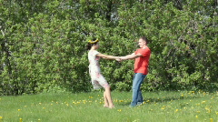 couple  dancing in green field - stock footage