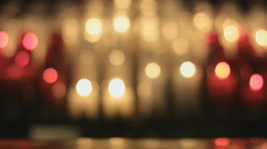 Out Of Focus Religious Prayer Catholic Candles On A Rack In A Cathedral Stock Footage