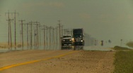 Trucking, Transport truck on highway very long shot Stock Footage