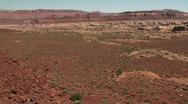 Distant car in big desert Stock Footage